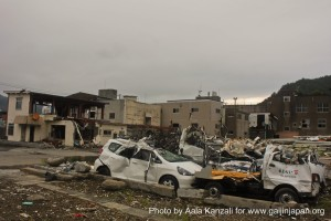 kamaishi, iwate, tohoku, japan - volunteer fro tsunami - destroyed cars